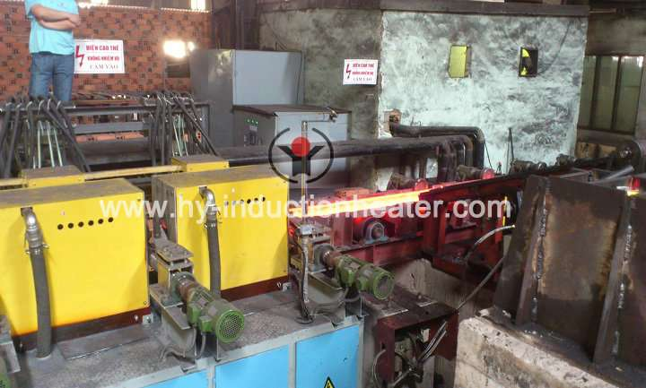Steel billet induction reheating furnace