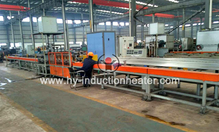 Long bar induction heat treatment